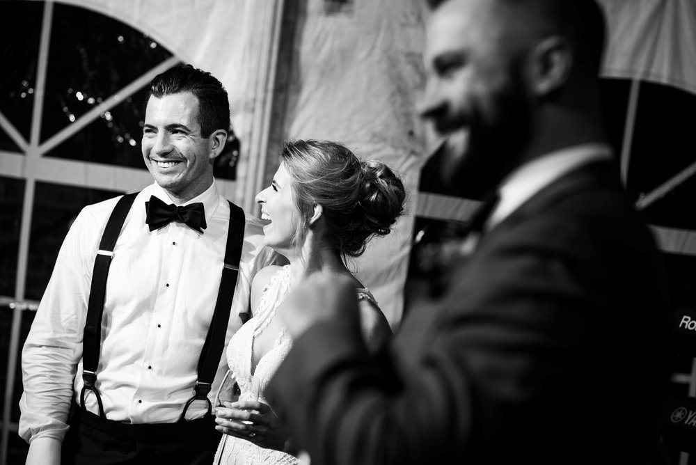 Bride and groom laugh to toasts during a Glessner House Chicago wedding reception.