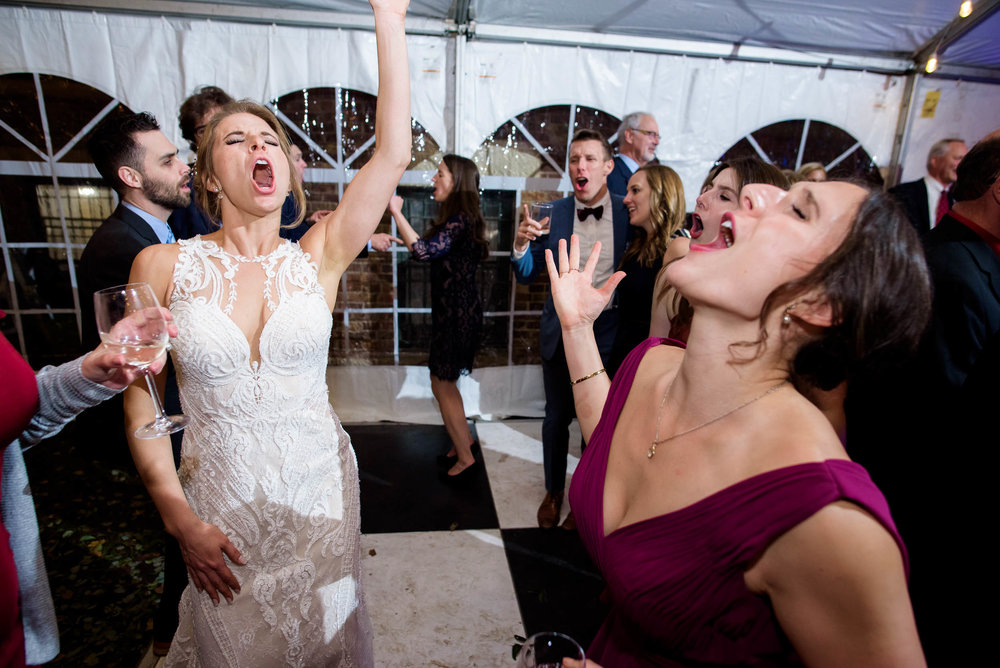 Bride and bridesmaid on the dance floor during a Glessner House Chicago wedding reception.