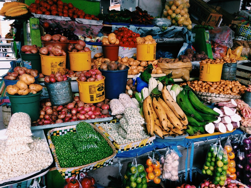 Mercado 9 de Decembre in Cuenca, Ecuador features an endless selection of potatoes, beans, peas, and exotic fruits like babaco, maracuya, and naranjillo.