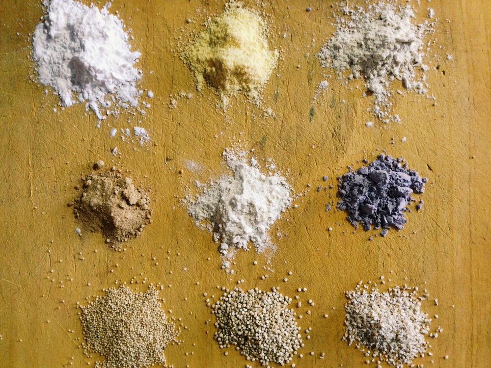 Top L to R: Harina de Yuca, Harina de Maiz, Harina de Platanos,  Middle L to R: Pinol, Harina de Quinoa/Trigo/Maiz, Harina de Negra Maiz  Bottom L to R: Amaranth, Quinoa, Barley