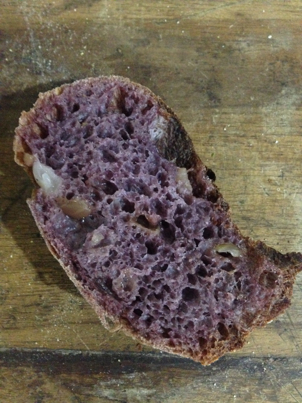A loaf made with caramelized onion, cumin, and blue corn flour.