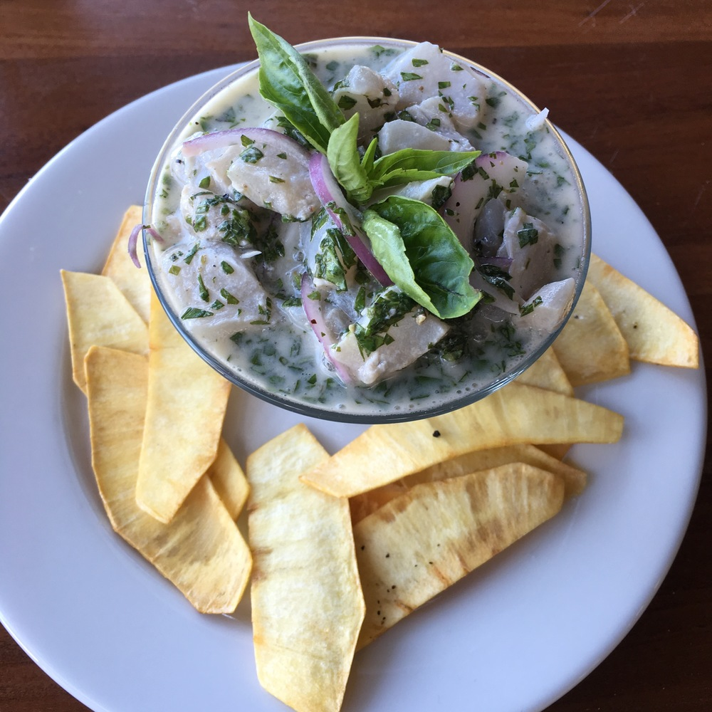 Breadfruit chips served alongside kingfish ceviche in an herbed coconut-lime marinade.