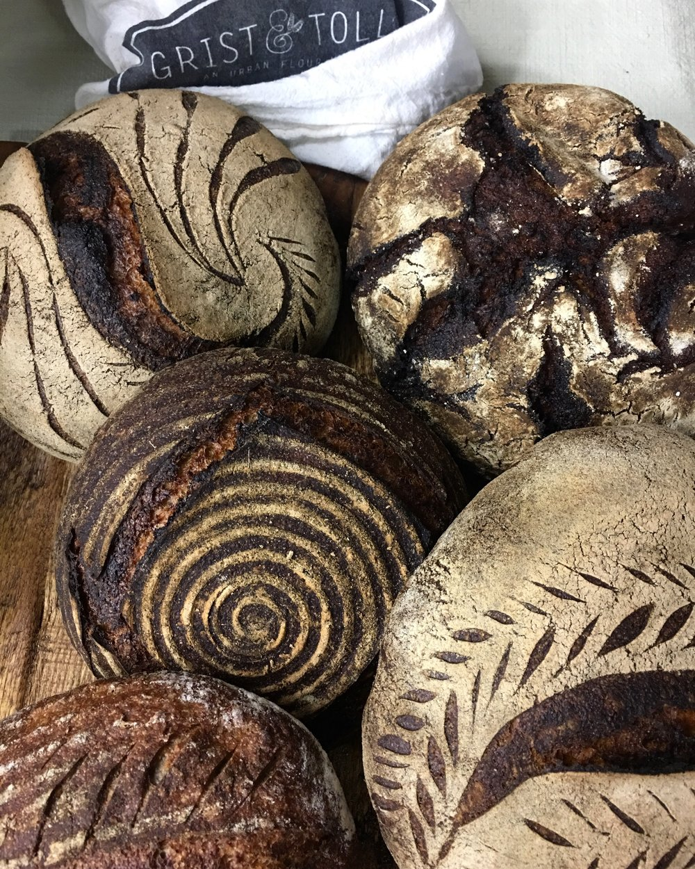Naturally-leavened loaves made with grain grown by the  Tehachapi Grain Project  and milled by  Grist & Toll.