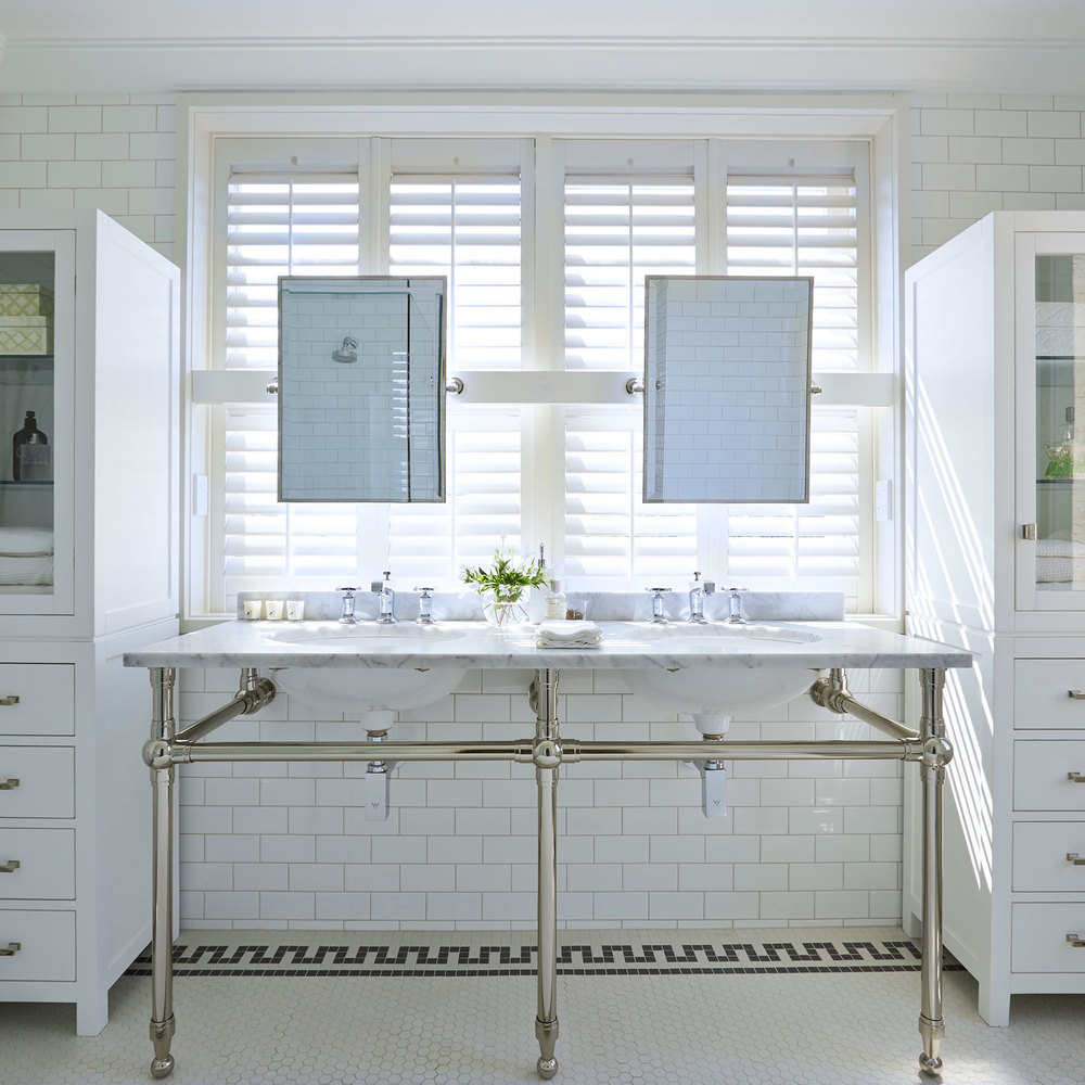 American style bathroom with subway and hexagon tile.