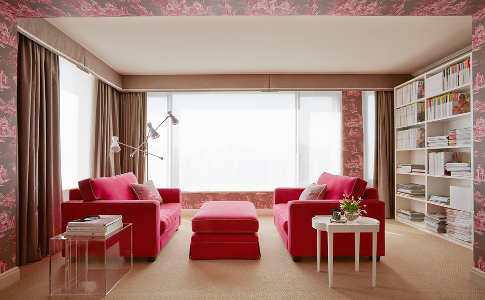 living-room-raspberry-fabric-lucite-table-bookshelf-manuel-canovas-wallpaper-diane-bergeron.jpg