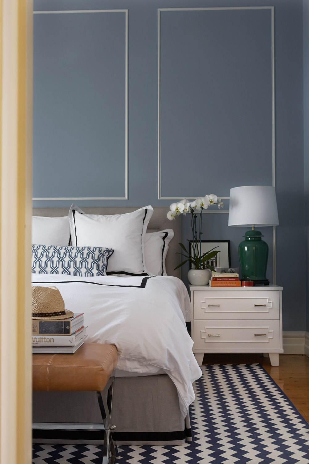 master-bedroom-blue-walls-tan-leather-stool-custom-black-white-linen-rug-diane-bergeron.jpg