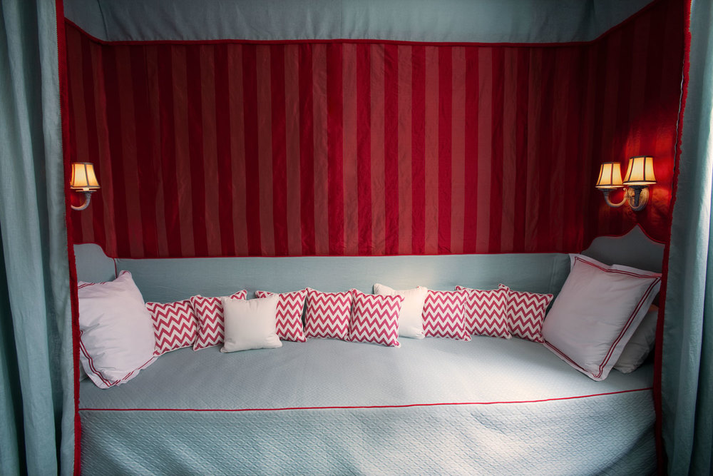 girls-bedroom-raspberry-pink-stripe-wallpaper-mint-green-linen-wall-sconce-zigzag-cushions-diane-bergeron.jpg