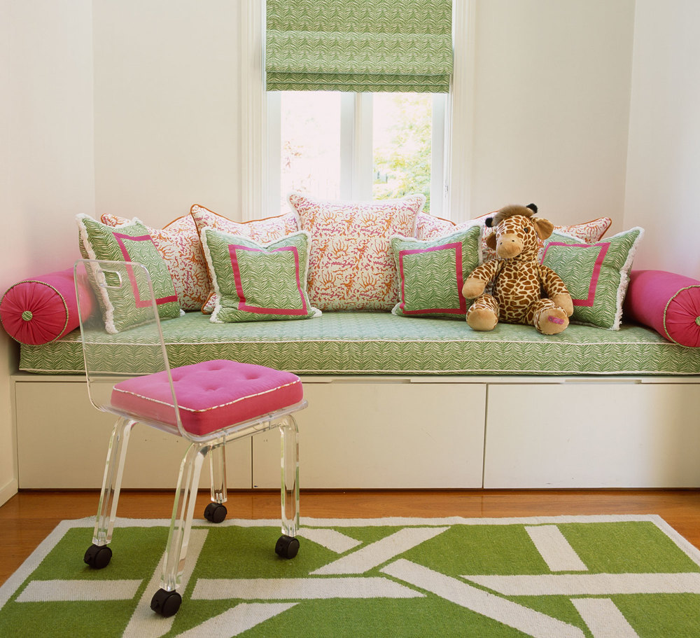 girls-window-seat-green-pink-patterned-cushions-custom-green-rug-lucite-chair-green-roman-blind-diane-bergeron.jpg