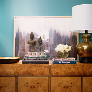 turquoise-aqua-blue-wall-entry-burle-wood-console-chest-gold-brass-vintage-table-lamp-buddha-books-print-diane-bergeron-300.jpg