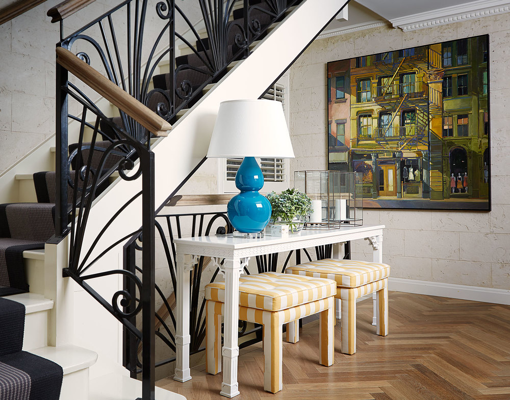 faux-bamboo-white-lacquer-console-light-oak-floorbaord-aqua-blue-table-lamp-black-grey-stair-runner-yellow-stripe-stool-diane-bergeron.jpg