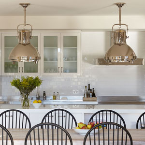beach-house-kitchen-nickel-oversized-pendant-lights-raw-timber-limewashed-dining-table-black-slatback-chair-white-joinery-diane-bergeron-300.jpg