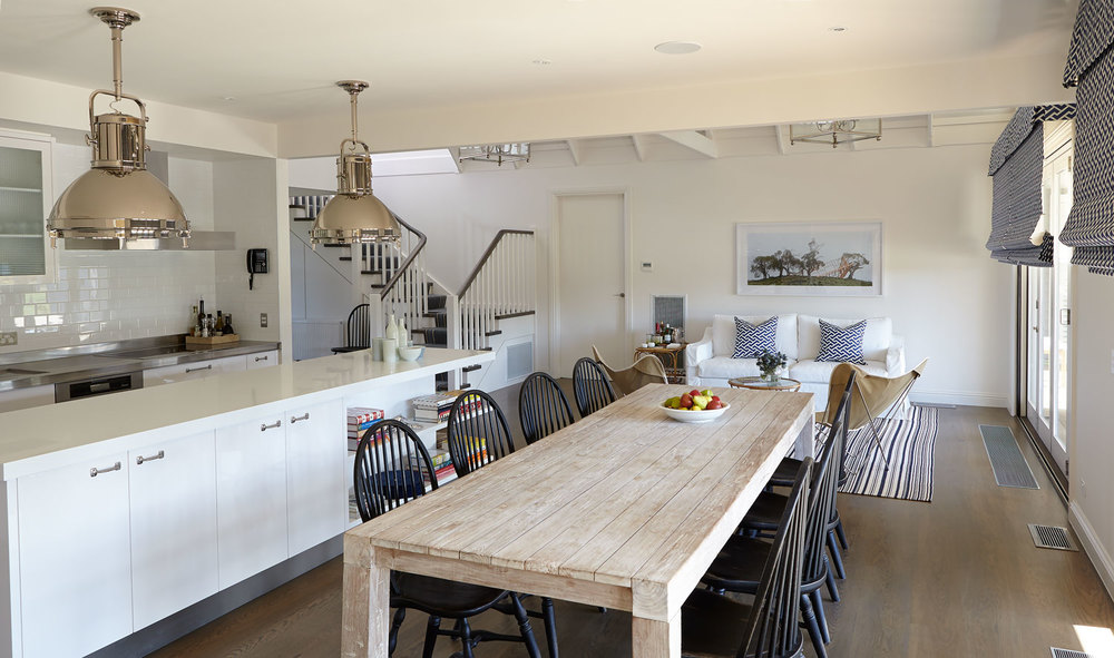 beach-house-kitchen-nickel-oversized-pendant-lights-raw-timber-limewashed-dining-table-black-slatback-chair-light-floorboard-roman-blind-diane-bergeron.jpg