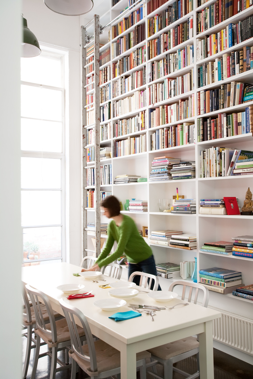casual-meals-area-white-dining-table-chairs-floor-to-ceiling-bookshelf-diane-bergeron.jpg