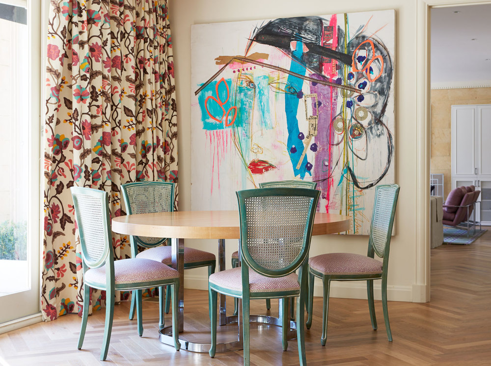 pink-brown-print-curtain-light-teal-cane-dining-chair-light-floorboard-modern-abstract-art-round-timber-dining-table-diane-bergeron.jpg
