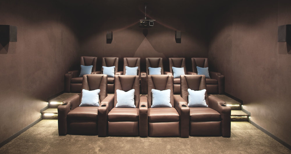 theatre-room-chocolate-brown-fabric-light-blue-cushion-brown-wall-diane-bergeron.jpg