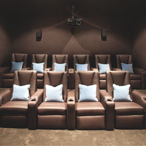 theatre-room-chocolate-brown-fabric-light-blue-cushion-brown-wall-diane-bergeron-300.jpg