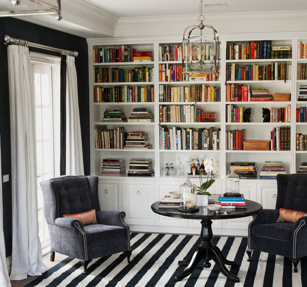 charcoal-wingback-chair-studded-pink-lumbar-cushion-white-linen-curtains-black-white-stripe-carpet-black-traditional-pedestal-centre-table-white-custom-joinery-bookshelf-nickel-pendant-diane-bergeron.jpg