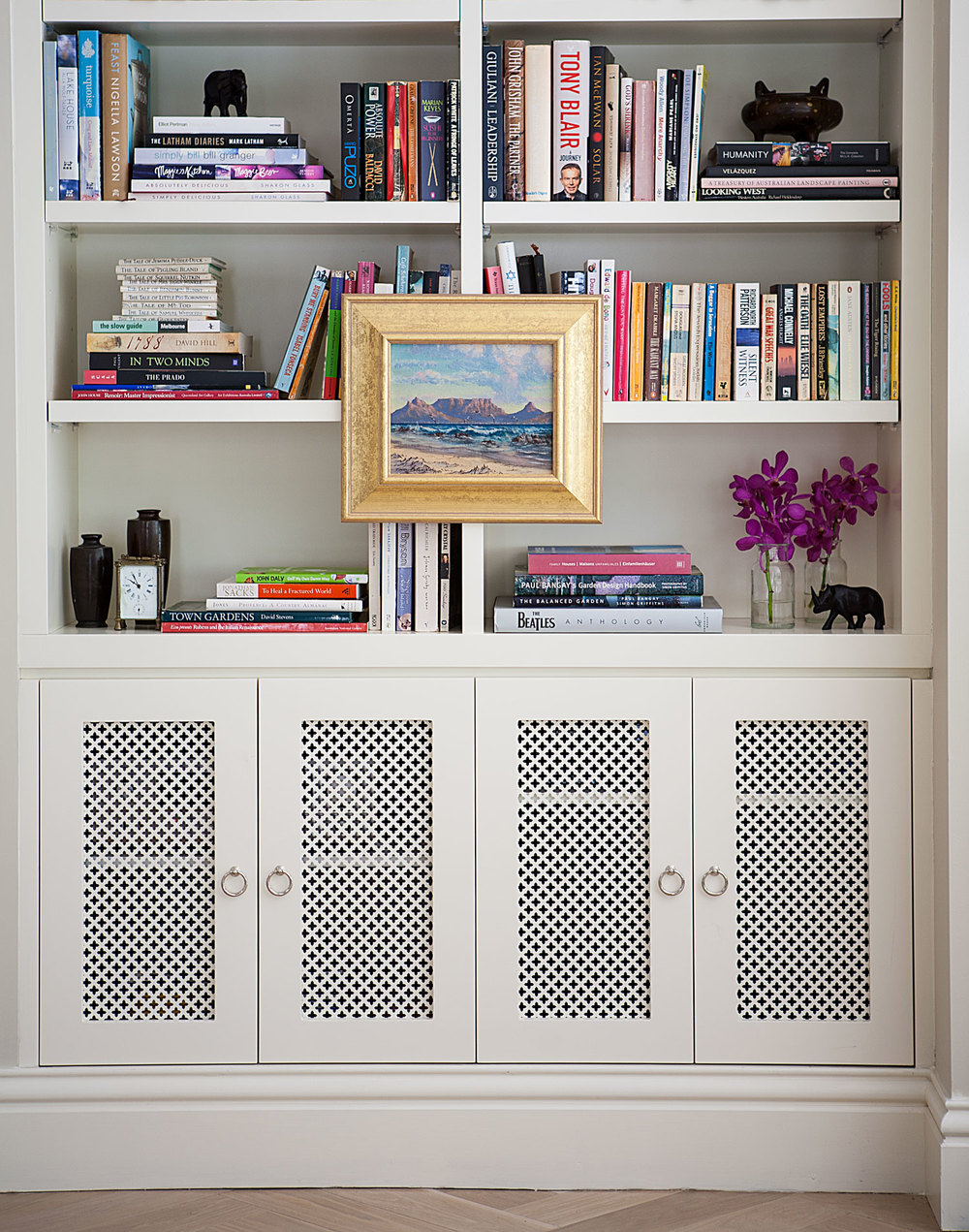 custom-joinery-bookshelf-white-lacquer-with-mesh-doors-book-display-mounted-print-diane-bergeron.jpg