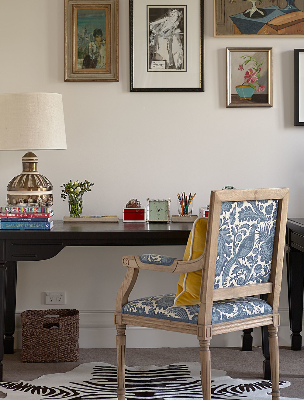 home-office-desk-black-lacquer-traditional-armchair-blue-printed-fabric-zebra--rug-vintage-lamp-gallery-prints-basket-yellow-cushion-diane-bergeron.jpg