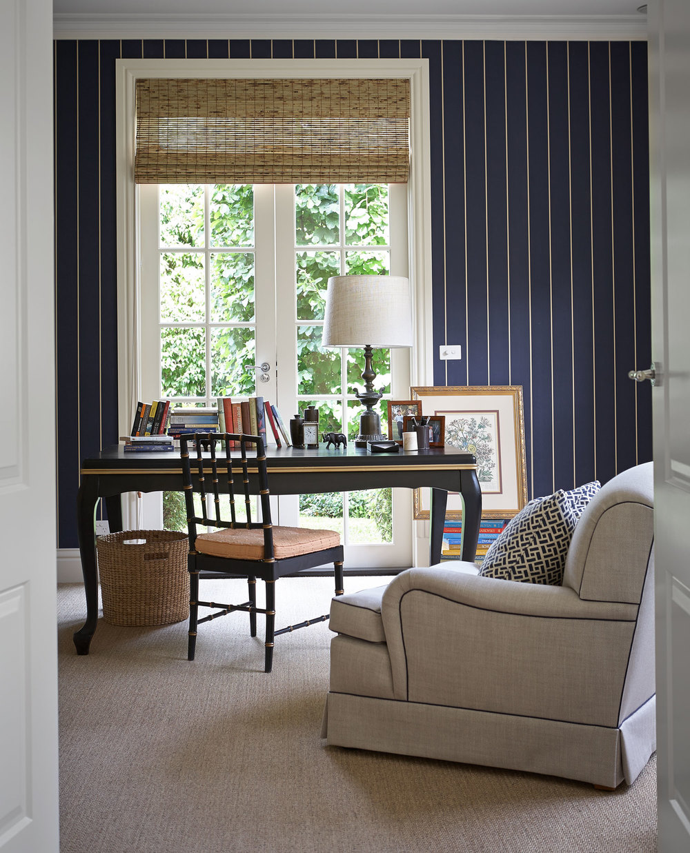 home-office-study-navy-white-stripe-wallpaper-black-lacquer-traditional-desk-beige-linen-armchair-bamboo-chair-basket-bamboo-roman-blind-diane-bergeron.jpg