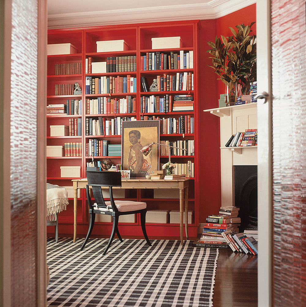 masculine-home-office-study-red-joinery-shelving-faux-bamboo-desk-black-chair-plaid-rug-timber-floorboards-fireplace-book-display-diane-bergeron.jpg