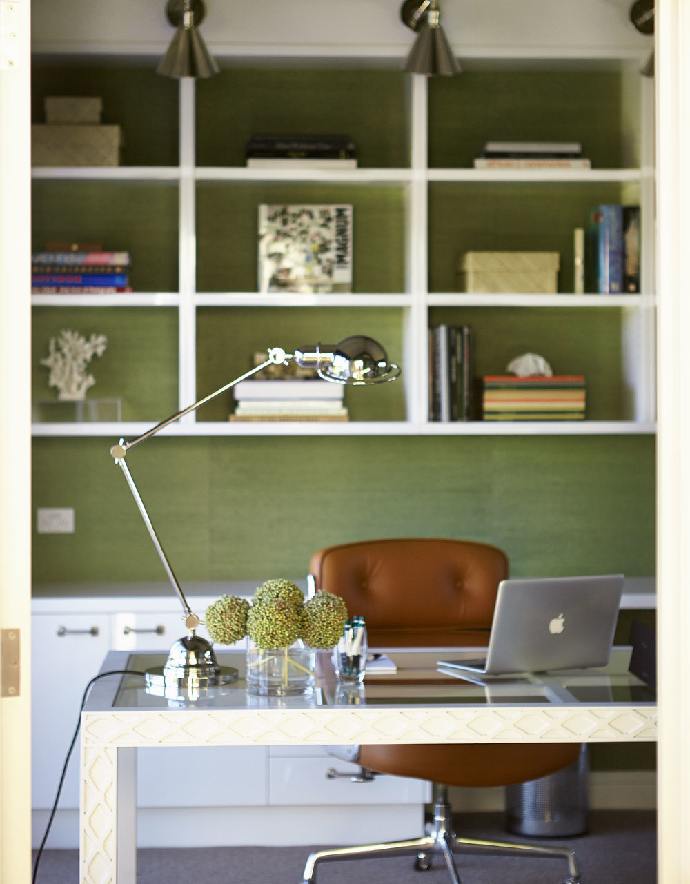 top-50-rooms-green-grasscloth-wallpaper-home-office-one-off-white-lacquer-glass-desk-nickel-wall-light-custom-joinery-tan-leather-eames-chair-nickel-adjustable-table-lamp-white-walls-diane-bergeron.jpg