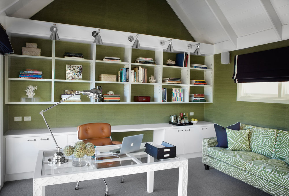 top-50-rooms-green-grasscloth-wallpaper-home-office-one-off-white-lacquer-glass-desk-printed-sofa-nickel-wall-sconce-custom-joinery-tan-leather-eames-chair-navy-roman-blind-diane-bergeron.jpg