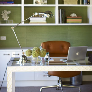 top-50-rooms-green-grasscloth-wallpaper-home-office-one-off-white-lacquer-glass-desk-nickel-wall-light-custom-joinery-tan-leather-eames-chair-nickel-adjustable-table-lamp-white-walls-diane-bergeron-300.jpg