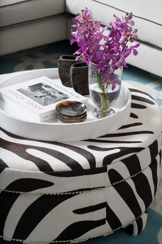 chocolate-white-zebra-round-ottoman-white-lacquer-round-tray-nickel-studs-diane-bergeron.jpg