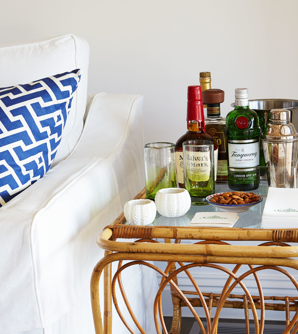 caned-side-table-bar-area-white-linen-sofa-blue-geometric-cushion-diane-bergeron.jpg