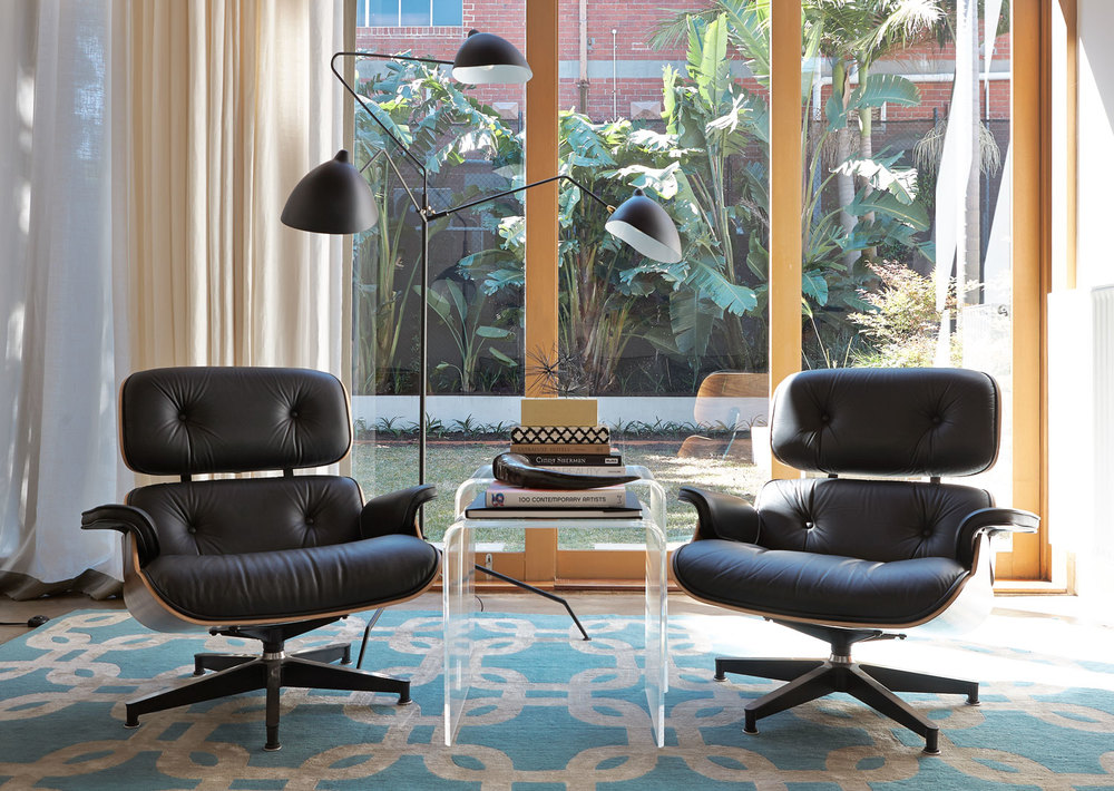 black-leather-eames-chairs-custom-rug-design-aqua-beige-links-lucite-side-table-black-vintage-floor-lamp-diane-bergeron.jpg