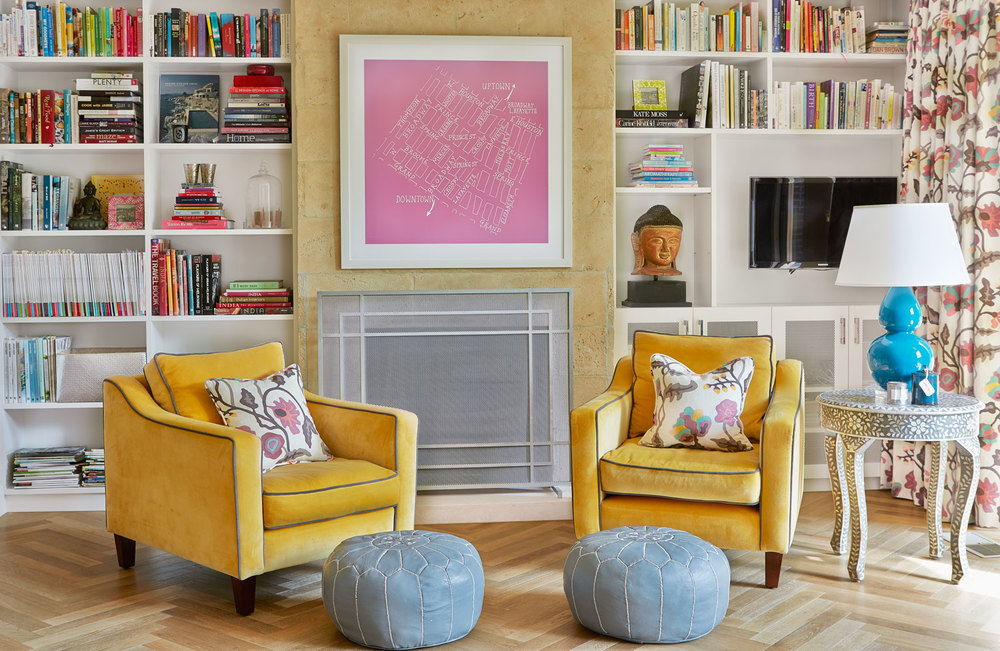living-room-mustard-velvet-lounge-chairs-blue-leather-poufs-custom-joinery-bookshelves-light-washed-oak-floorboards-aqua-ceramic-table-lamp-pink-print-diane-bergeron.jpg