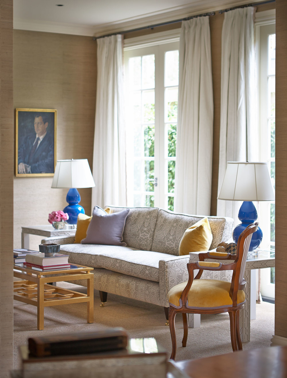 living-room-royal-blue-ceramic-lamps-collette-sofa-quadrille-printed-fabric-taupe-neutral-mustard-velvet-gold-leaf-coffee-table-white-linen-window-dressing-diane-bergeron.jpg