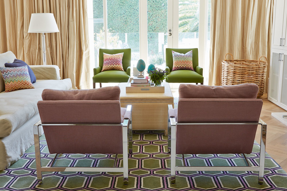 living-room-green-geometric-rug-camel-stainless-lounge-chairs-green-occasional-chairs-beige-slipcovered-sofa-wicker-basket-diane-bergeron.jpg