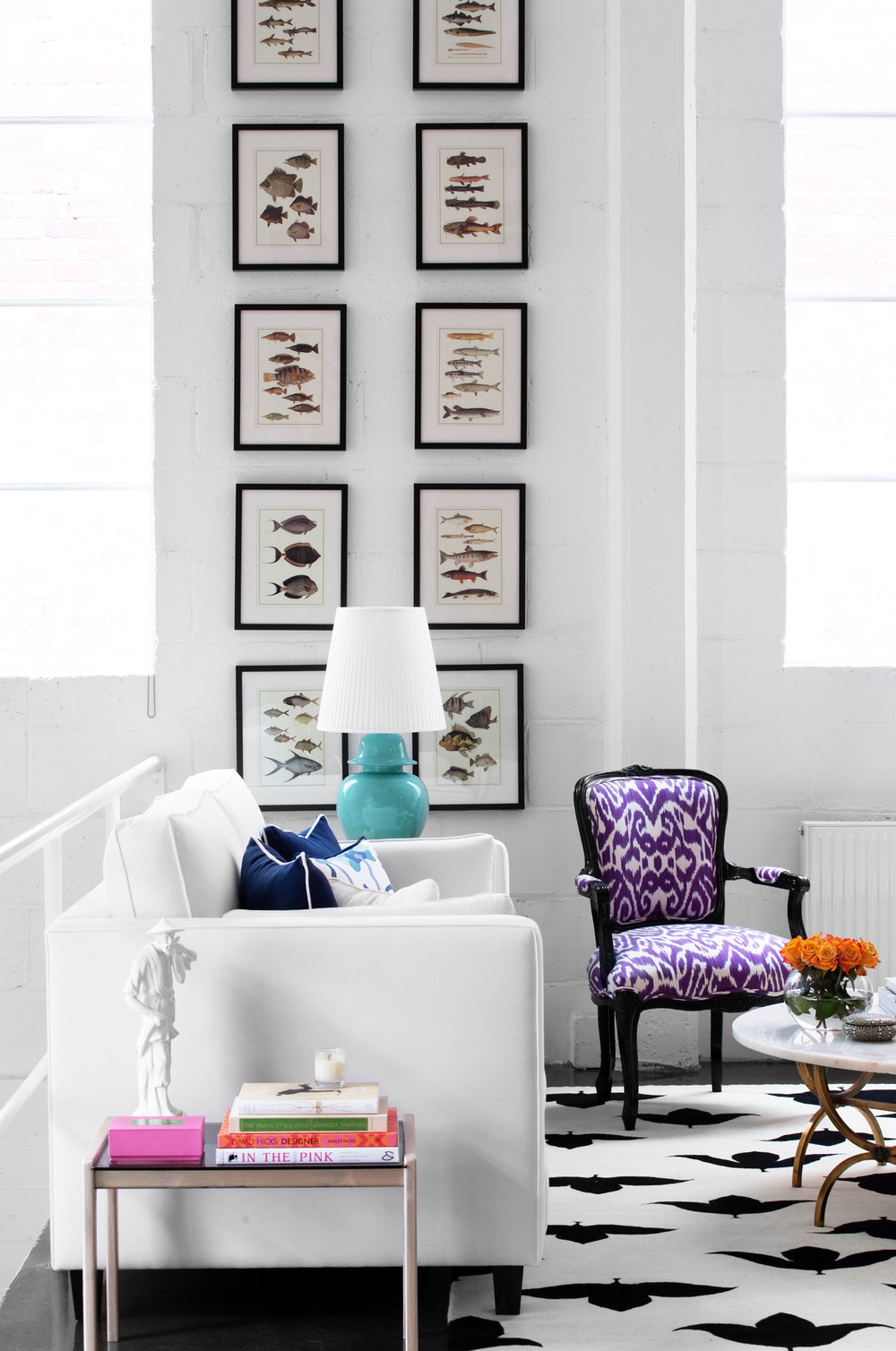 diane-bergeron-office-space-white-linen-slipcovered-sofa-purple-damask-louis-chair-aqua-veramic-table-lamp-fish-gallery-prints-black-and-white-madeline-winerib-cotton-rug-marble-coffee-table-diane-bergeron.jpg