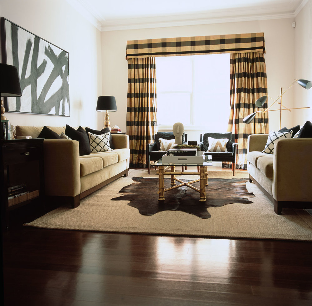 camel-black-living-room-plaid-window-dressing-sisal-rug-black-side-table-and-cushions-bamboo-glass-coffee-table-hide-rug-charcoal-lounge-chairs-vintage-lamps-floorboards-timber-diane-bergeron.jpg