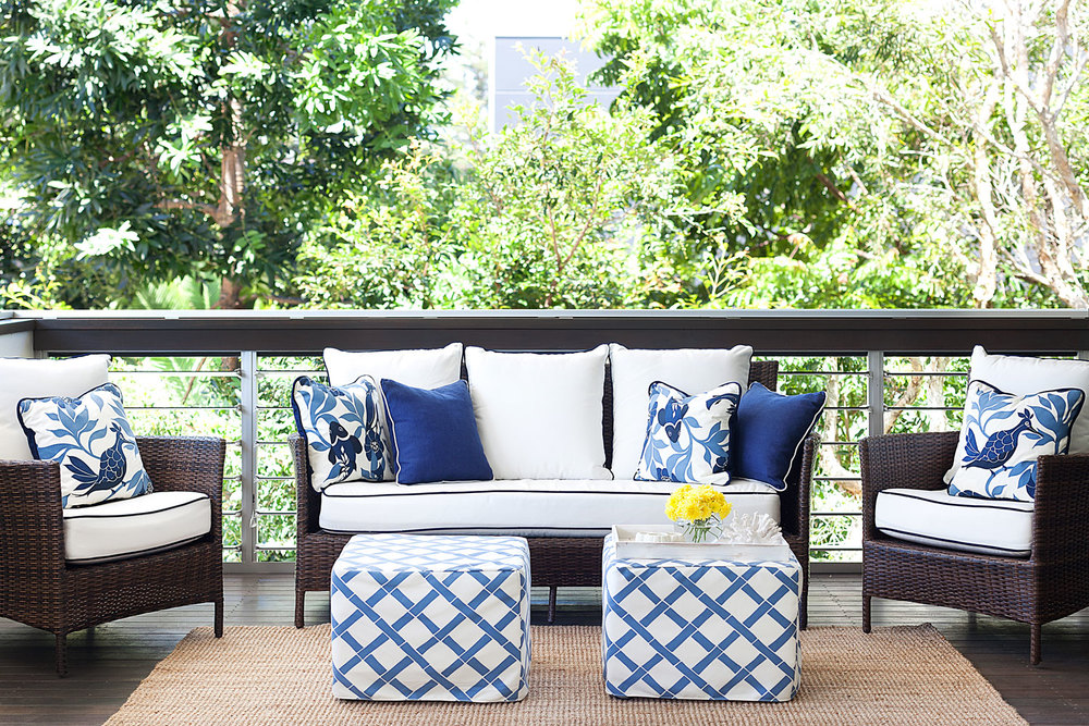 Charming White Wicker Furniture #2: Outdoor-living-blue-white-wicker-lounge-chairs-ottoman-footstool-outdoor-rug-contrast-piping-diane-bergeron.jpg