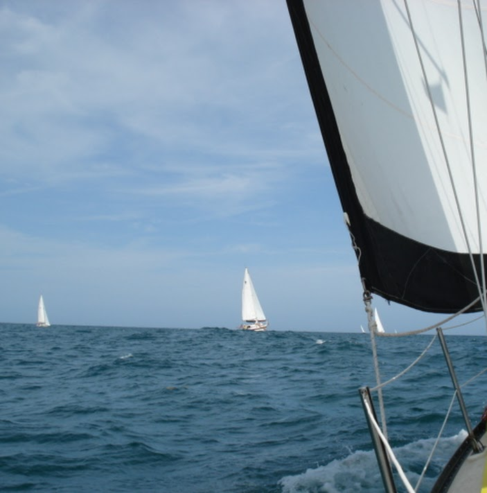 Boats racing on the horizon.jpg