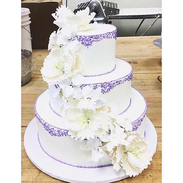 White Flowers with Purple stitching.jpg