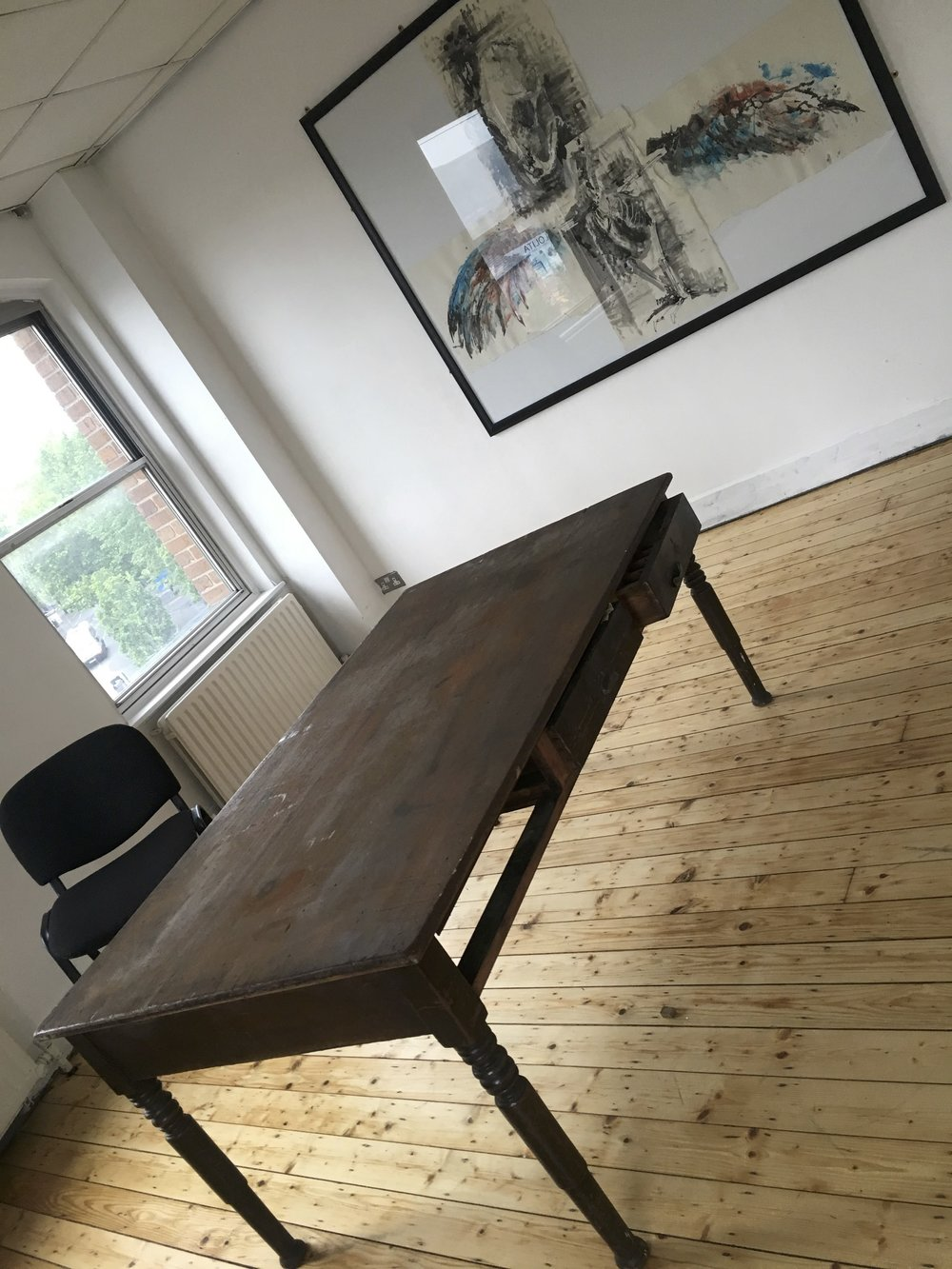 A reclaimed desk from the basement becomes our meeting room table
