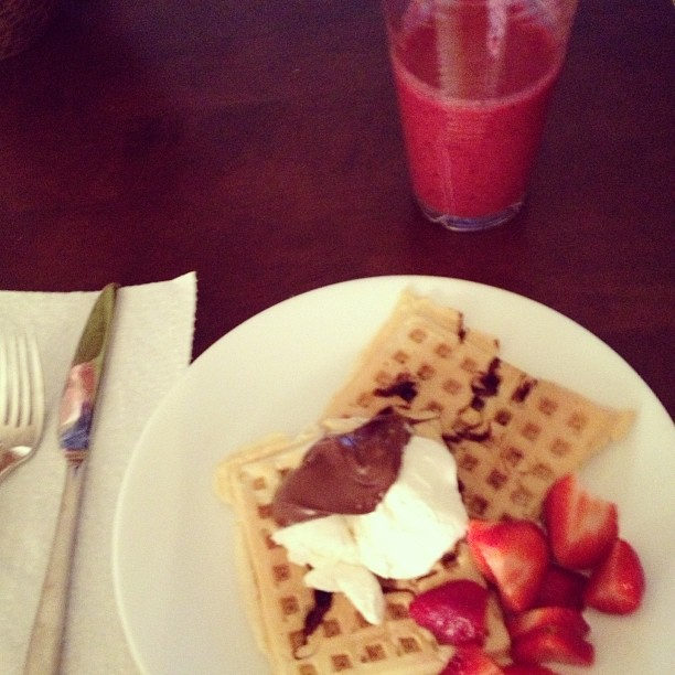 Belgian waffles, strawberries, and cool whip with a very berry smoothie