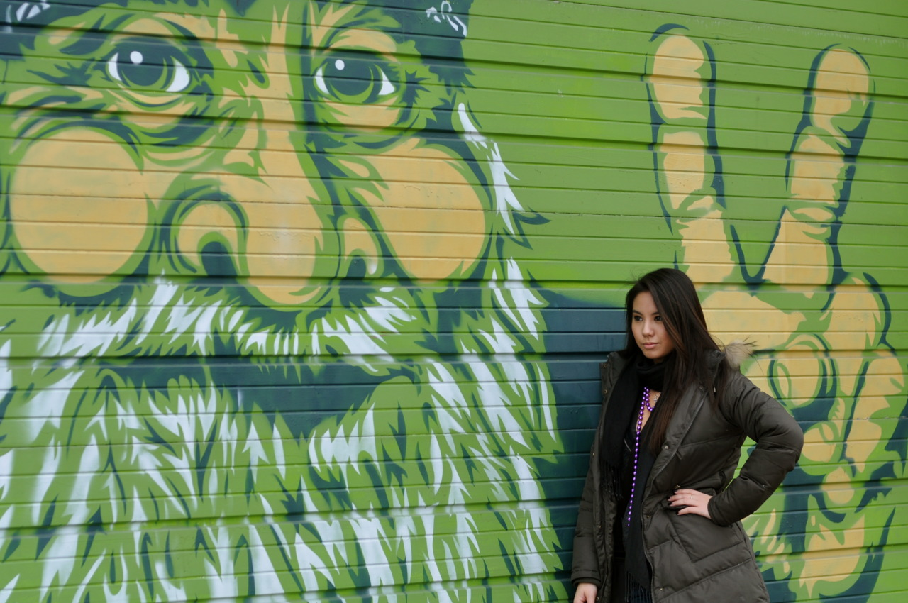 Stephanie against the graffiti on Mardi Gras in Saint Louis