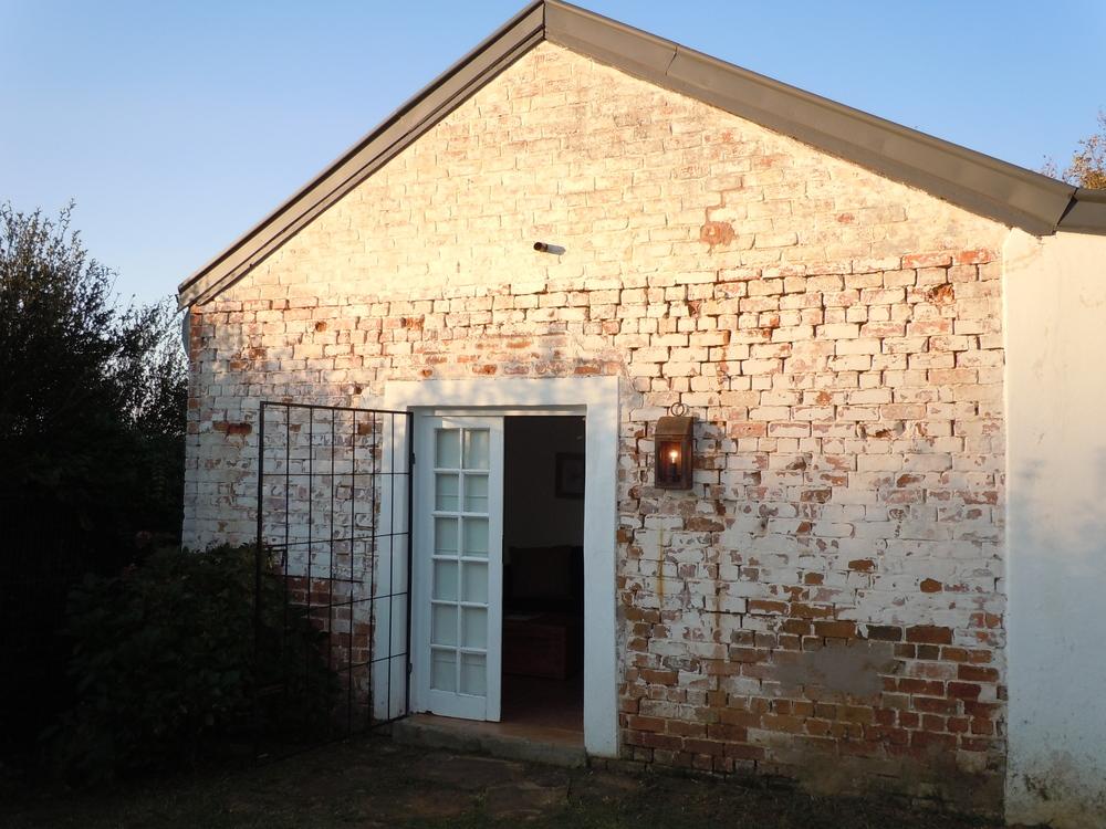 Postmaster's cottage outside.JPG