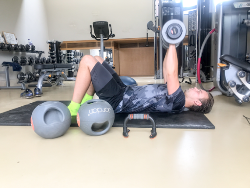 Driver Tom Chilton doing dumbbell floor press