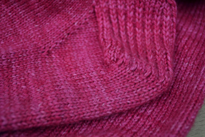 Turning the heel creates the little wedge of stitches that is just under the heel flap, seen here on Charlie's Petunia sock.