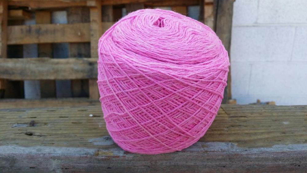 One skein of Breeze in the colorway Hyacinth wound into one center-pull ball.