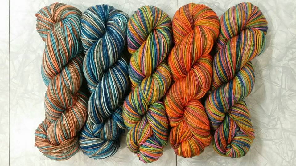 A few of our OOAK variegated skeins.