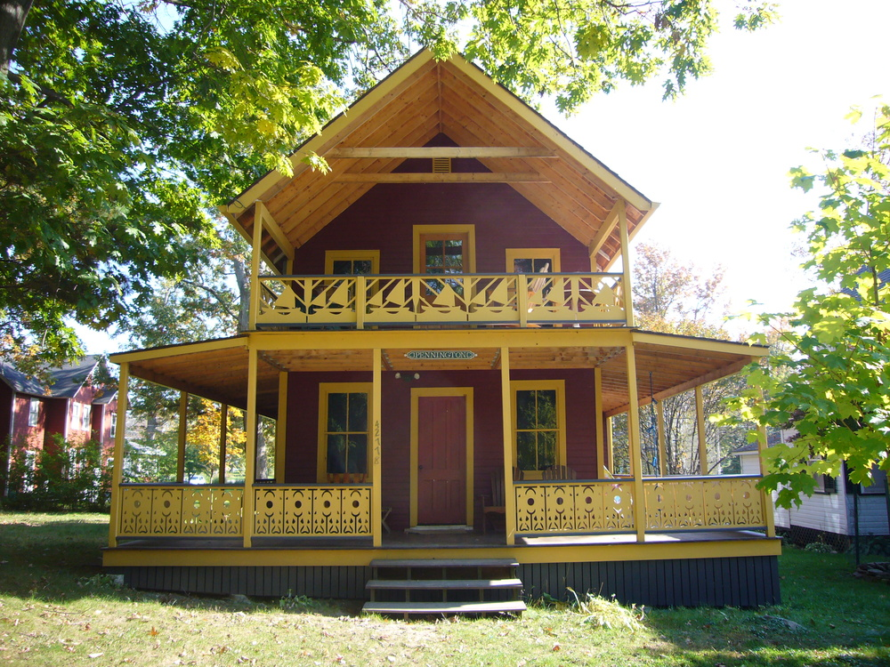 North Elevation - After the renovation, a downstairs wrap-around porch with an upstairs sleeping porch is added to the main entry façade.