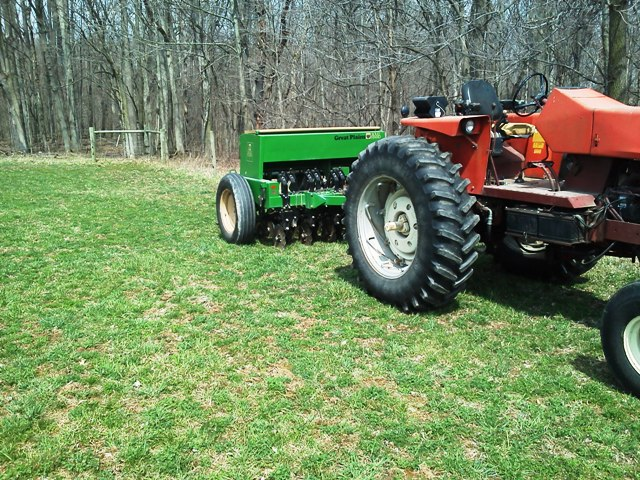 If the ground is ready to be driven on, a no-till drill will do the job.