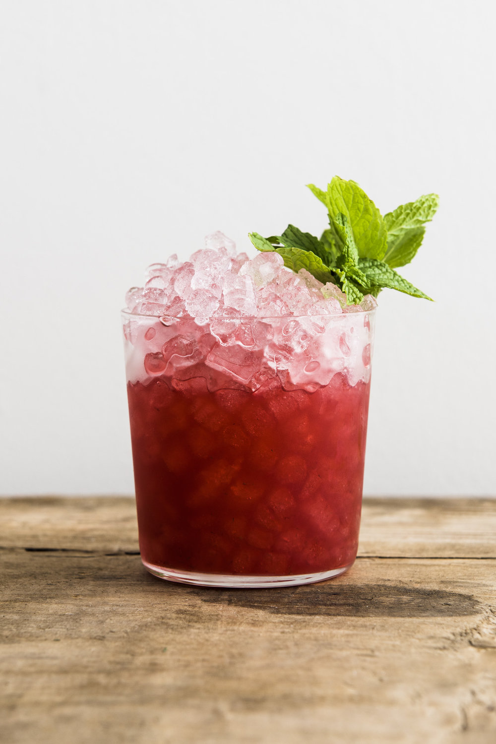 REDWOOD   1 1/2 oz Bourbon  1/2 oz Chareau  3/4 oz Fresh Lemon Juice  1/4 oz Honey Syrup  4-5 Blackberries  Muddle blackberries in shaking tin. Add bourbon, Chareau, fresh lemon juice, and honey. Shake all ingredients with ice. Strain and pour over crushed ice.